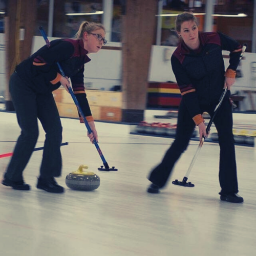 two_female_athletes_curling